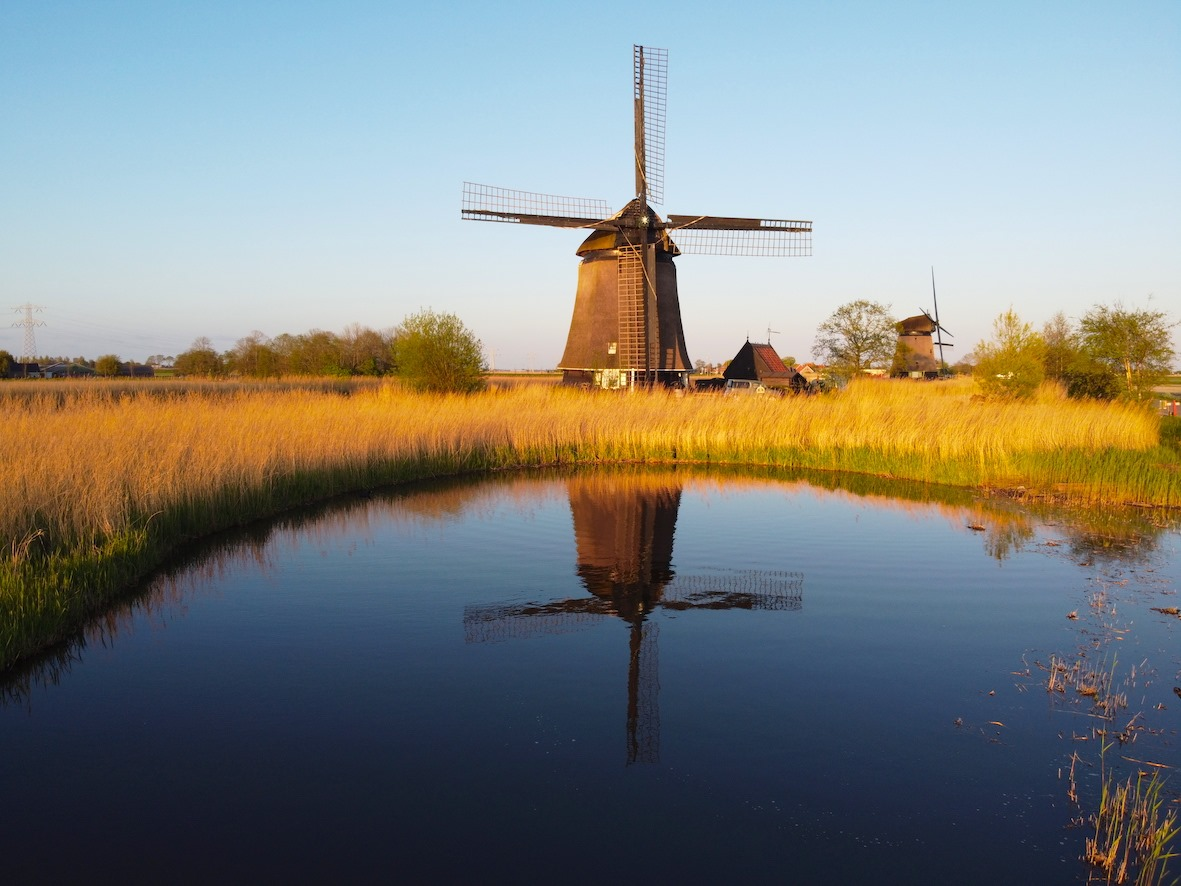 Reflection of a Dutch windmill in a small lake by Tom van der Leij.