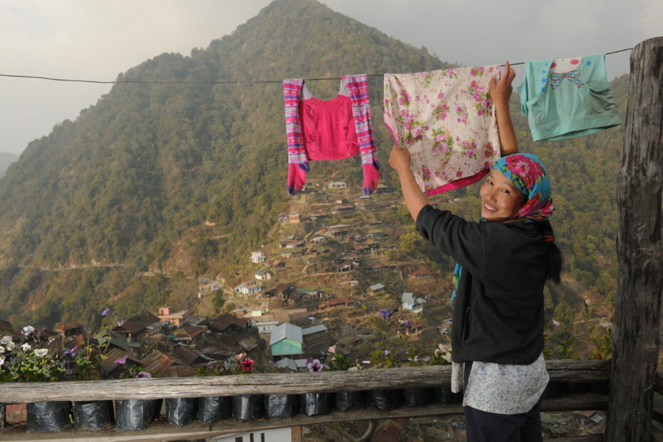 B&B owner hangs the wash in Nagaland, India by Amsterdam photographer Tom van der Leij