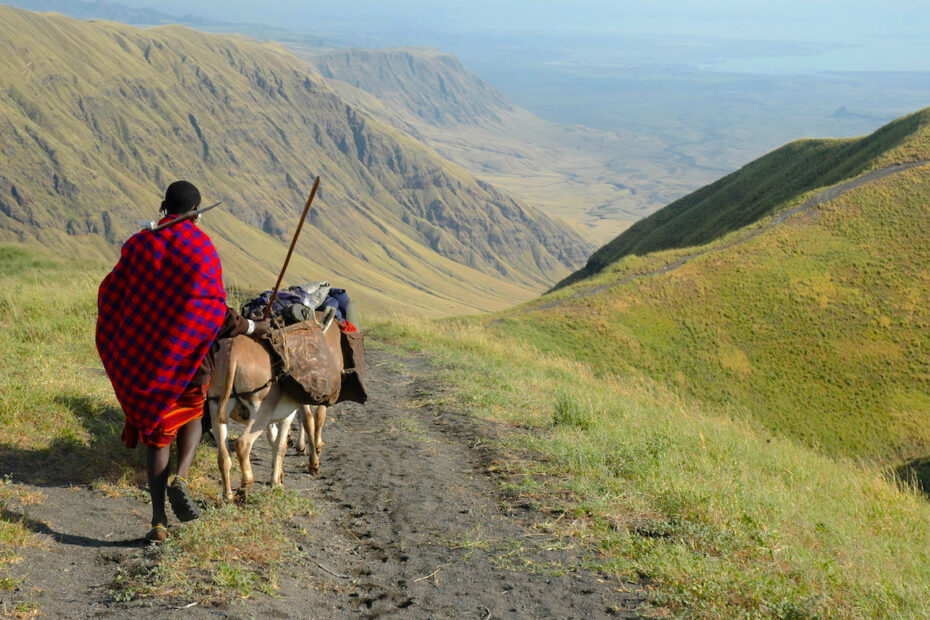 Maasai man walking in East Rift Valley by Amsterdam photographer Tom van der Leij