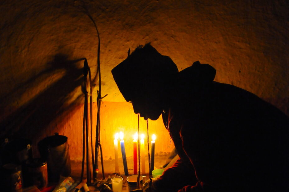 Medicine man in Sangoma South Africa by candlelight