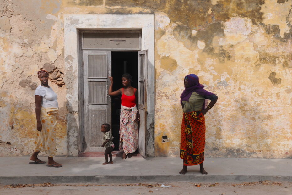 Women talking in front of old building in Mozambique